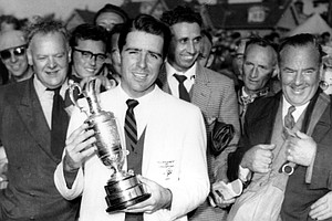 Gary Player, 23-year-old from South Africa, poses with trophy after winning the British Open Golf Championship at Murifield, Scotland on July 3, 1959. Player is the youngest golfer to win the title since 1868.