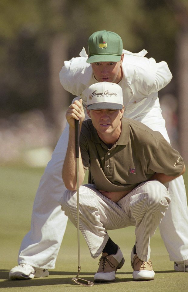 Davis Love III lines up his putt on the 10th with his caddy, brother Mark Love, during the final round of the Masters at the Augusta National Golf Club in Augusta, Ga., Sunday, April 9, 1995. Love made a birdie on the hole.