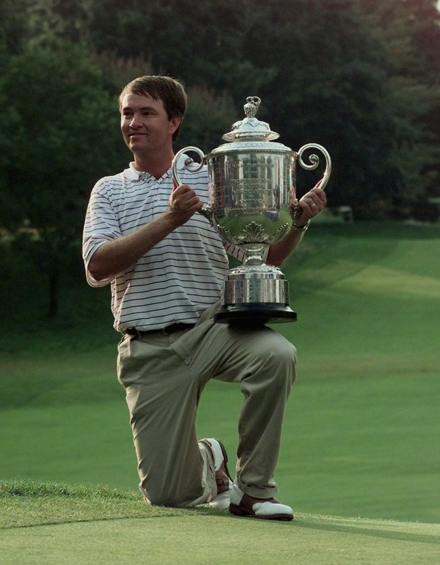 Davis Love III holds the trophy after he won the PGA Championship at Winged Foot Golf Club in Mamaroneck, N.Y., Sunday, August 17, 1997. Love finished the four rounds at -11.
