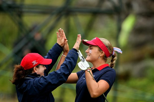 Team USA's Alexis Thompson, right, and Team Manager Donna Mummert celebrate clinching the first point during the singles matches of the 2010 Curtis Cup at Essex County Club.