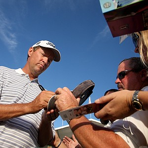 Davis Love III signs autographs for fans after winning the Children's Miracle Network Classic in Lake Buena Vista, FL.