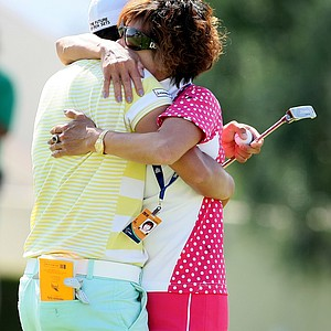Yani Tseng gets a hug from her mother, Yu Yun Yang after winning the Kraft Nabisco Championship on the Dinah Shore Tournament Course in Mission Hills.