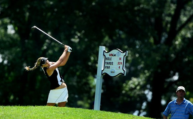 Alexis Thompson hits her tee shot at no. 14 during semifinal match play of the 109th U. S. Women's Amateur Championship at Old Warson Country Club in St. Louis, MO.