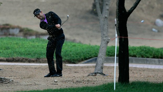 Charl Schwartzel plays a shot from the rough at the 11th during the second round of the Abu Dhabi Golf Championship.