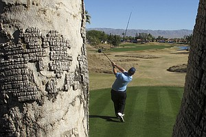 David Duval tees off at the Bob Hope Classic.