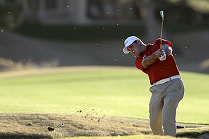 Gary Woodland blasts out of a bunker during the third round of the Bob Hope Classic.