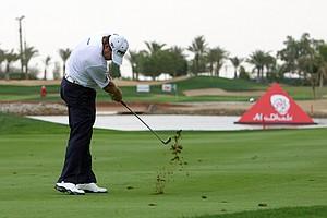 Lee Westwood plays a shot at the sixth hole at Abu Dhabi Golf Club.