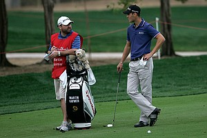 Abu Dhabi leader Martin Kaymer with his caddie.