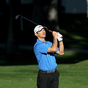Professional ballroom dancer Tony Dovolani of TV's 'Dancing with the Stars' hits his second shot on the second hole during Round 2 of the Bob Hope Classic at the La Quinta Country Club.