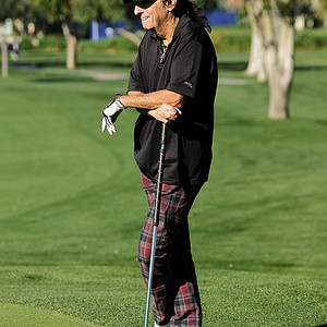Musician Alice Cooper waits to putt on the first hole during round two of the Bob Hope Classic at the La Quinta Country Club.