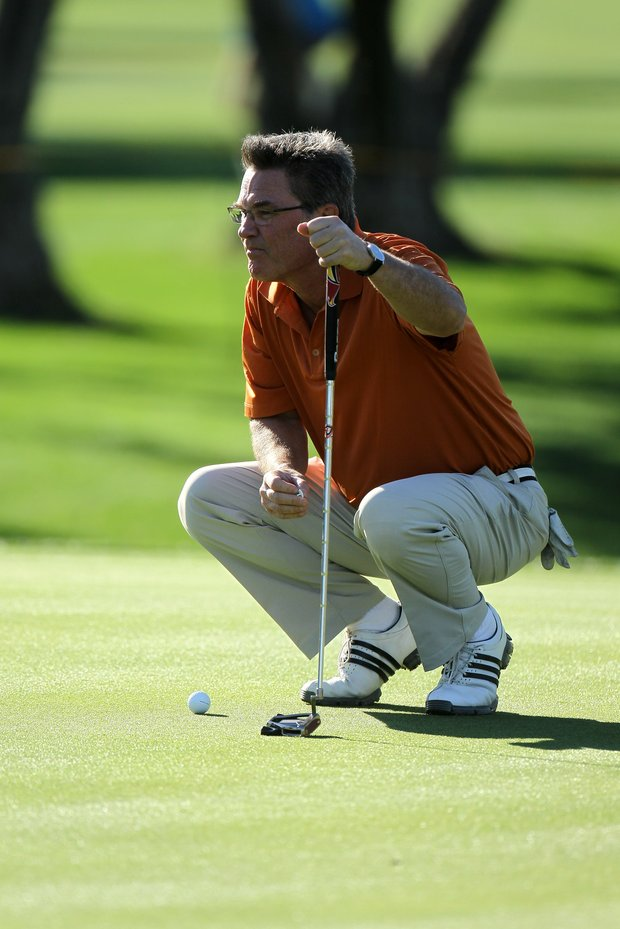 Actor Kurt Russell lines up a putt on the 11th hole during round two of the Bob Hope Classic at the La Quinta Country Club on January 20, 2011 in La Quinta, California.