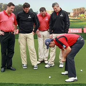 Padraig Harrington of Ireland (R) offers advice to (L-R) Simon Cooper, the CEO of HSBC Middle East and North Africa, HSBC sporting ambassadors Chris Cairns, Jonathan Davies and Gavin Hastings at a golf skills clinic during the third round of The Abu Dhabi HSBC Golf Championship.