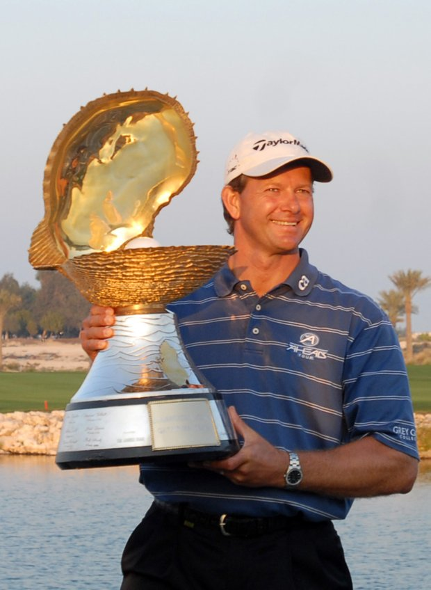 South Africa's Retief Goosen holds the trophy after he won the Qatar Masters golf tournament in Doha, Qatar, Sunday, Jan. 28, 2007.