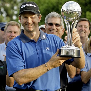 Retief Goosen, of South Africa, holds his trophy after winning the Transitions Championship golf tournament Sunday, March 22, 2009, at Innisbrook in Palm Harbor, Fla. Goosen finished with an eight-under-par 276.