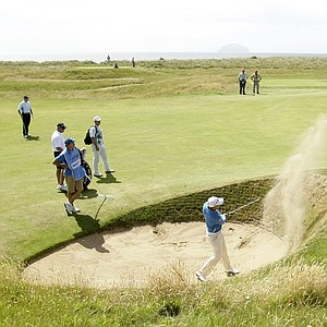 Matteo Manassero of Italy plays from a bunker on the 17th hole during practice for the British Open Golf championship, at the Turnberry golf course, Scotland, Wednesday, July 15, 2009.