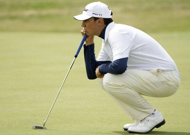 Matteo Manassero of Italy lines up a putt on the eighth green during the third round of the British Open Golf championship, at the Turnberry golf course, Scotland, Saturday, July 18, 2009.