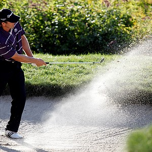 Retief Goosen, of South Africa, hits out of a sand trap onto the 18th green during the third round of the Deutsche Bank Championship golf tournament in Norton, Mass., Sunday, Sept. 6, 2009.