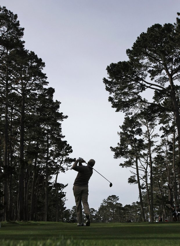 Retief Goosen, of South Africa, hits from the 18th tee during the first round of the AT&T Pebble Beach National Pro-Am golf tournament at Spyglass Hill golf course in Pebble Beach, Calif., Thursday, Feb. 11, 2010.