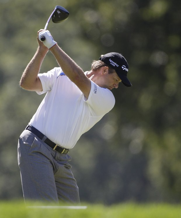 Retief Goosen, of South Africa, hits his tee shot on the ninth hole during the final round at the BMW Championship golf tournament in Lemont, Ill., Sunday, Sept. 12, 2010.