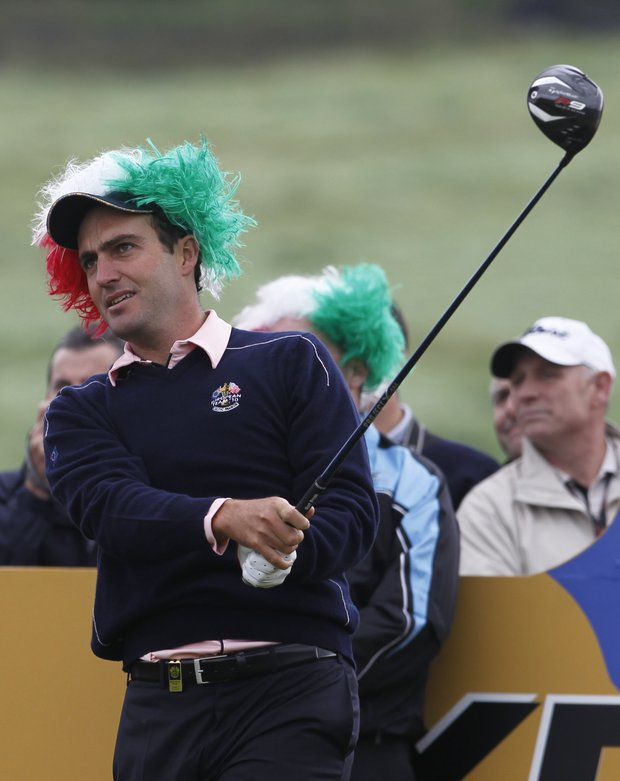 Europe's Edoardo Molinari, wearing a wig with the colours of the Italian flag, plays a shot from the 16th tee during a practice round prior to the 2010 Ryder Cup golf tournament at the Celtic Manor golf course in Newport, Wales, Thursday, Sept. 30, 2010.