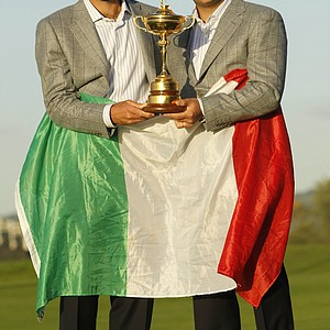 Europe's Edoardo Molinari, left, and Francesco Molinari hold the trophy with an Italian flag after Europe won the 2010 Ryder Cup golf tournament at the Celtic Manor Resort in Newport, Wales, Monday, Oct. 4, 2010.