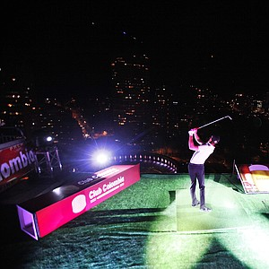 Golfer Camilo Villegas, of Colombia swings at a golf ball on top of a building, towards the hole in the Santa Maria bullfight ring in Bogota, Colombia, Thursday, Oct. 7, 2010. Villegas failed the attempt.