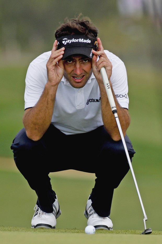 Edoardo Molinari, from Italy, lines up his putt on the 7th hole during the third round of the Portugal Masters golf tournament on Saturday, Oct. 16, 2010 at Victoria golf course in Vilamoura, south Portugal.