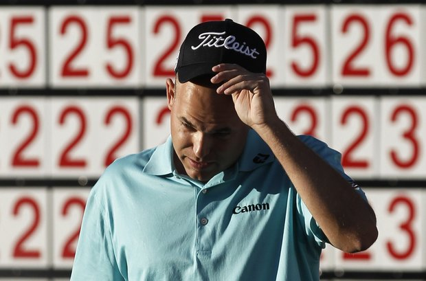 Bill Haas reacts after missing a birdie putt on the 18th hole during the final round of the Bob Hope Classic in La Quinta, Calif., Jan. 23, 2011.