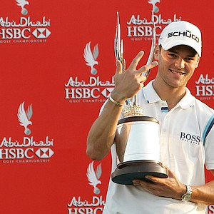 Germany's Martin Kaymer holds the trophy after winning the Abu Dhabi Golf Championships in Abu Dhabi, United Arab Emirates, for the third time in four years, Sunday, Jan. 23, 2011.