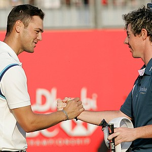 Germany's Martin Kaymer left shakes hands with Rory McIlroy of Northern Ireland after he wins the Abu Dhabi Golf Championships in Abu Dhabi, United Arab Emirates, Sunday, Jan. 23, 2011.