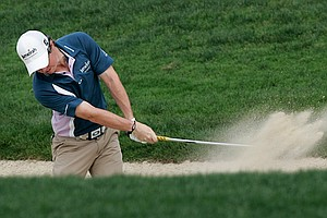 Rory McIlroy of Northern Ireland plays a ball from the bunker on the third hole during the final round of the Abu Dhabi Golf Championships in Abu Dhabi, United Arab Emirates, Sunday, Jan. 23, 2011