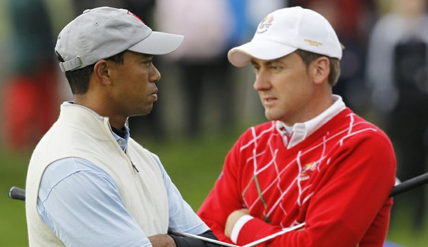 Tiger Woods, left, and Europe's Ian Poulter on the fourth green during the 2010 Ryder Cup.