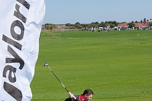 A golfer hits the new white TaylorMade R11 driver on Demo Day of the 2011 PGA Merchandise Show.