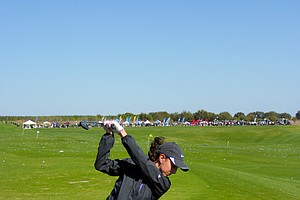 A player tests out hybrids at the Adams Golf booth on Demo Day of the 2011 PGA Merchandise Show.