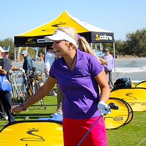 Lexi Thompson laughs while hitting balls at the Cobra-Puma booth on Demo Day of the 2011 PGA Merchandise Show.
