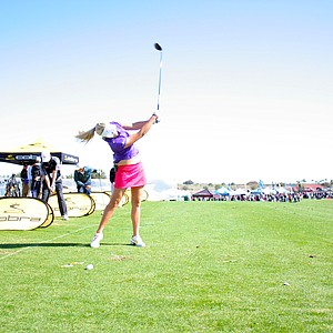 Lexi Thompson hits balls at the Cobra-Puma booth on Demo Day of the 2011 PGA Merchandise Show.