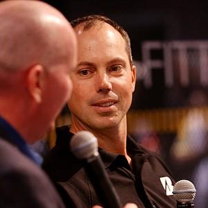 Matt Kuchar answers questions from an XM radio golf analyst at the Bridgestone booth.