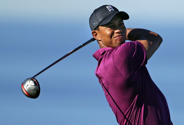 Tiger Woods watches his tee shot on the 13th hole of the North Course at Torrey Pines during the first round of the Farmers Insurance Open golf tournament in San Diego, Thursday, Jan. 27, 2011.