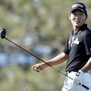 Sunghoon Kang. of South Korea, looks back to watch his tee shot on the ninth hole of the North Course at Torrey Pines during the first round of the Farmers Insurance Open golf tournament in San Diego, Thursday, Jan. 27, 2011. Kang finished at 8-under-par.