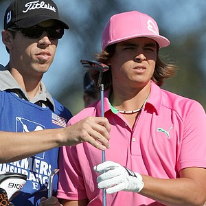 Rickie Fowler, right, and caddie Joe Skovron during the first round of the Farmers Insurance Open at Torrey Pines.