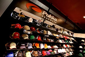 Pukka Headwear's booth consisted of shelves of hats with custom-designed color combinations and logos. The company's hats are not inventory-based, and customers are able to choose exactly the colors featured on the hat's stitching, eyelets, buttons and panels.