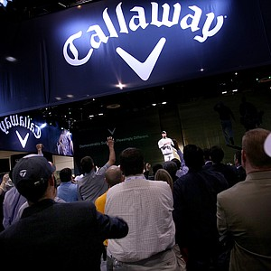 Callaway models strut down the runway to loud music, tossing free gloves, balls and assorted apparel into the crowd.