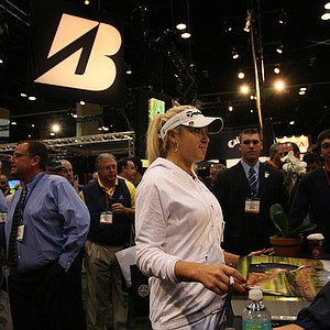 Natalie Gulbis talks to a fan at the Winn Grips booth.
