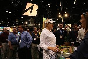 Natalie Gulbis talks to a fan at the Winn Grips booth.