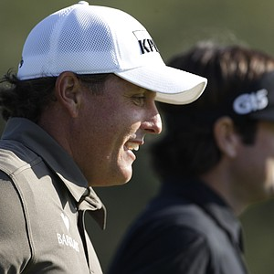 Phil Mickelson and Bubba Watson during Round 3 of the Farmers Insurance Open.