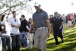 Tiger Woods shot a third-round 74 to fall eight shots off the pace.