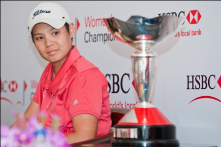 Christabel Goh glances at the trophy that will be on offer when she lines up in the HSBC Women's Champions, Feb. 24-27.