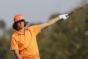 Rickie Fowler points toward the left rough where he hits his tee shot on the second hole of the South Course at Torrey Pines during the final round of the Farmers Insurance Open golf tournament in San Diego, Sunday, Jan. 30, 2011.