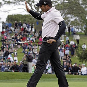 Jhonattan Vegas, of Venezuela, slaps his putter after missing a putt on the fifth hole of the South Course at Torrey Pines during the final round of the Farmers Insurance Open golf tournament in San Diego, Sunday, Jan. 30, 2011.