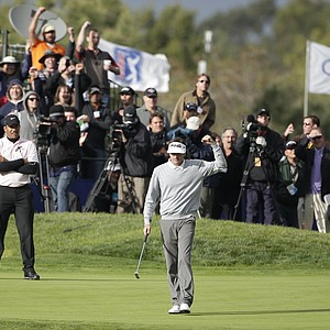 Bubba Watson pumps his fist after sinking a birdie putt on the 18th hole of the South Course at Torrey Pines that propelled him to victory in the Farmers Insurance Open golf tournament in San Diego, Sunday, Jan. 30, 2011. Jhonattan Vegas, of Venezuela, stands at left.